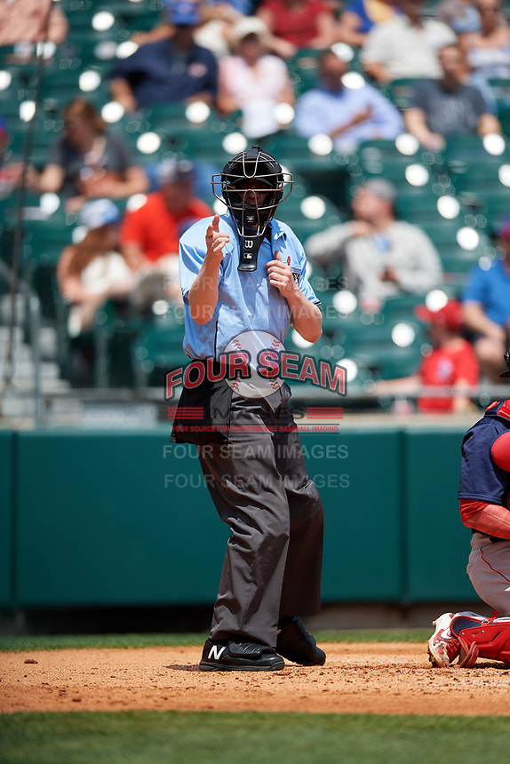 Home plate umpire Ryan Wills calls a strike during a game between the Pawtucket Red Sox and the Buffalo Bisons on June 28, 2018 at Coca-Cola Field in Buffalo, New York.  Buffalo defeated Pawtucket 8-1.  (Mike Janes/Four Seam Images)