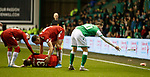 20.12.2019 Hibs v Rangers: Martin Boyle removes bottle from the pitch as Borna Barisic recieves treatment