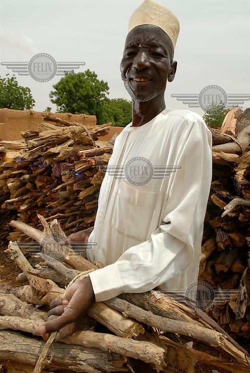 Tchima Jigo sells firewood in Nakikarchi village.