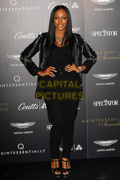 Alexandra Burke.Quintessentially Awards held at One Marylebone - Arrivals, London, England..28th September 2011.full length black jacket top hands on hips trousers .CAP/CJ.©Chris Joseph/Capital Pictures.