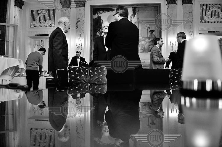 Secretary General Michel Drobet (centre) talking with a group of men during the annual press conference of the Swiss Private Bankers Association, held in the luxury Bellevue Palace Hotel. .. /Felix Features