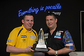 20.05.2015. London,  England. Betway Premier League Darts, Play-Offs Media Day. [L-R] Dave Chisnall and reigning World Champion Gary Anderson with the Betway Premier League Trophy.