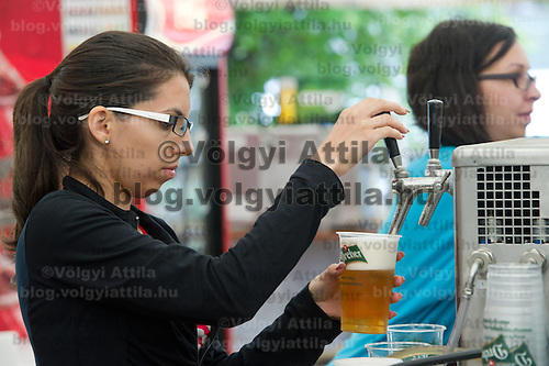 A worker drafts beer in a pub on Sziget festival held in Budapest, Hungary on August 07, 2011. ATTILA VOLGYI