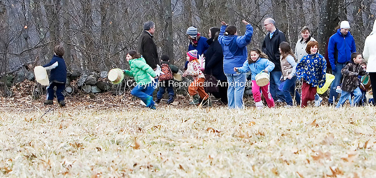 WOODBURY, CT- 16 MARCH 2008- 031608JT05-<br /> Children dash out onto a field and hunt for Easter eggs at Flanders Nature Center in Woodbury on Sunday during the Family Fun egg hunt.<br /> Josalee Thrift / Republican-American