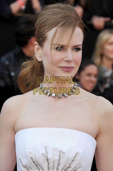 NICOLE KIDMAN .arriving at the 83rd Annual Academy Awards at the Kodak Theatre in Los Angeles, California, USA,.February 27th, 2011..oscars arrivals  portrait headshot hair up fringe necklace  strapless white  beaded.CAP/ROT/TM.©TM/Roth Stock/Capital Pictures