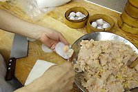 China, Hong Kong S.A.R..Dim Sum at Lin Heung Tea House, a traditional dim sum restaurant..Making of shrimp dim sum.