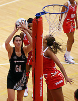 28.10.2014 Silver Ferns Jodi Brown and England's Geva Mentor in action during the Silver Ferns V England netball match played at the Rotorua Events Centre in Rotorua. Mandatory Photo Credit ©Michael Bradley.