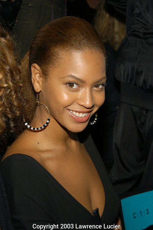 NEW YORK - SEPTEMBER 13: (US TABS AND HOLLYWOOD REPORTER OUT) Recording artist Beyonce Knowles appears at the Baby Phat Spring/Summer 2004 Collection fashion show September 13, 2003 in Bryant Park in New York City.