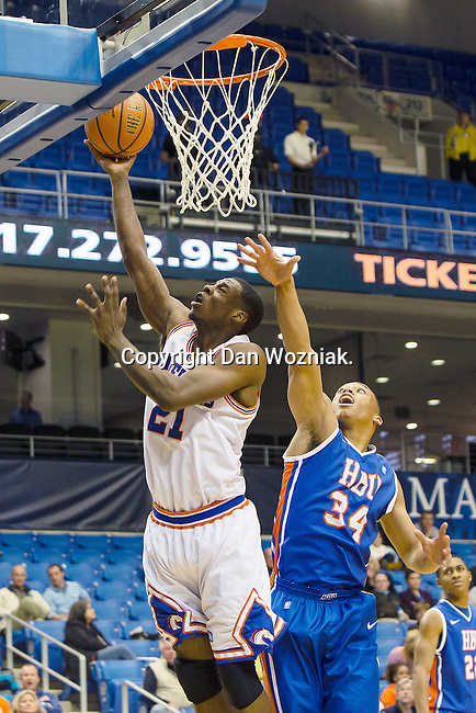 Texas-Arlington Mavericks forward Greg Gainey (21) and Houston Baptist Huskies guard/forward Caleb Crayton (34) in action during the game between the Houston Baptist Huskies and the Texas-Arlington Mavericks at the College Park Center arena in Arlington, Texas. UTA defeats Houston Baptist 81 to 47...