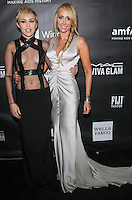 HOLLYWOOD, LOS ANGELES, CA, USA - OCTOBER 29: Miley Cyrus, Tish Cyrus arrive at the 2014 amfAR LA Inspiration Gala at Milk Studios on October 29, 2014 in Hollywood, Los Angeles, California, United States. (Photo by Celebrity Monitor)