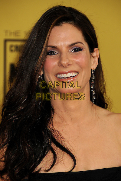 SANDRA BULLOCK.15th Annual Critics' Choice Movie Awards - Arrivals held at the Hollywood Palladium, Hollywood, California, USA, 15th January 2010..portrait headshot black strapless dangly earring smiling .CAP/ADM/BP.©Byron Purvis/Admedia/Capital Pictures
