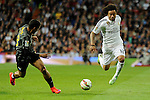 Real Madrid´s Marcelo Vieira and Malaga´s Roberto Jose Rosales during 2014-15 La Liga match between Real Madrid and Malaga at Santiago Bernabeu stadium in Madrid, Spain. April 18, 2015. (ALTERPHOTOS/Luis Fernandez)