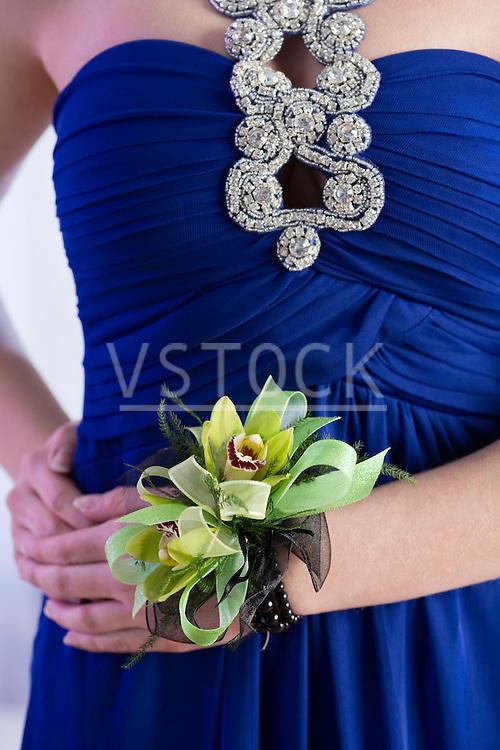 Teenage girl (14-15) wearing wristlet