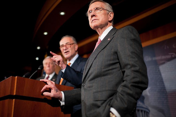 UNITED STATES - SEPTEMBER 23:  From left, House Minority Whip Steny Hoyer, D-Md., Sen. Charles Schumer, D-N.Y., and Senate Majority Leader Harry Reid, D-Nev., conduct a news conference in the Capitol on a potential vote Monday on a measure to fund the government and the Federal Emergency Management Agency.  (Photo By Tom Williams/Roll Call)