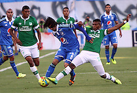 BOGOTA -COLOMBIA. 05-04-2014. Rafael Robayo   (Izq) de Millonarios  disputa el balon contra Carlos Renteria del Deportivo Cali partido por la  quinceava  fecha de La liga Postobon 1 disputado en el estadio Nemesio Camacho El Campin. /   Rafael Robayo  (L)  of Millonarios   fights the ball against Carlos Renteria of Deportivo Cali   during the match for the fifteenth round of The Postobon one league match at Nemesio Camacho El Campin  Stadium . Photo: VizzorImage/ Felipe Caicedo / Staff