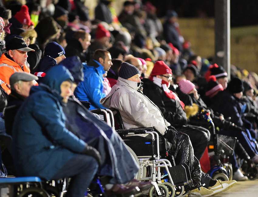 Lincoln City fans watch their team in action<br /> <br /> Photographer Andrew Vaughan/CameraSport<br /> <br /> The EFL Sky Bet League Two - Saturday 15th December 2018 - Lincoln City v Morecambe - Sincil Bank - Lincoln<br /> <br /> World Copyright © 2018 CameraSport. All rights reserved. 43 Linden Ave. Countesthorpe. Leicester. England. LE8 5PG - Tel: +44 (0) 116 277 4147 - admin@camerasport.com - www.camerasport.com