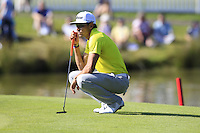 Rafael Cabrera-Bello (ESP) lines up his putt on the 18th green during Friday's Round 2 of the 2014 Irish Open held at Fota Island Resort, Cork, Ireland. 20th June 2014.<br /> Picture: Eoin Clarke www.golffile.ie