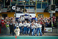 """The blended crew of the #48 team and the """"over the wall"""" group from the sister-ship #24 celebrate the championship win."""