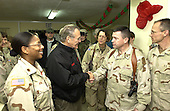 United States Secretary of Defense Donald H. Rumsfeld meets with staff members from the 67th Combat Surgical Hospital while at Mosul Airfield, Iraq, December 24, 2004. Rumsfeld traveled to Iraq to show is support to service members and visit patients and staff from the 67th Combat Surgical Hospital. <br /> Mandatory Credit: James M. Bowman / DoD via CNP