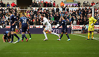Pictured: Michu of Swansea (C) celebrating his goal to the disappointment of Tottenham players. Saturday 30 March 2013<br /> Re: Barclay's Premier League, Swansea City FC v Tottenham Hotspur at the Liberty Stadium, south Wales.