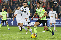 (L-R) Matt Grimes of Swansea City and George Baldock of Sheffield United in action during the Sky Bet Championship match between Swansea City and Sheffield United at the Liberty Stadium, Swansea, Wales, UK. Saturday 19 January 2019