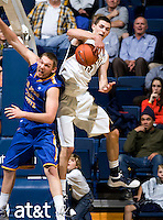 David Kravish of California rebounds the ball during the game against SJSU at Haas Pavilion in Berkeley, California on December 7th, 2011.   California defeated San Jose State, 81-62.