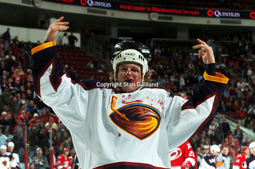 The Atlanta Thrashers' Karl Stewart (42) motions to the crowd as he is escorted off the ice by an official after a fight with Carolina Hurricanes' Chad Larose Wednesday, Jan. 4, 2006 in Raleigh, NC. Carolina won 4-3.