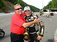 Jun. 17, 2012; Bristol, TN, USA: NHRA top fuel dragster driver Tony Schumacher (right) celebrates with his father and team owner Don Schumacher after winning the Thunder Valley Nationals at Bristol Dragway. Mandatory Credit: Mark J. Rebilas-