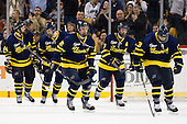 Stephane Da Costa (Merrimack - 24), Jesse Todd (Merrimack - 16), Brendan Ellis (Merrimack - 22), Karl Stollery (Merrimack - 7) and Mike Collins (Merrimack - 13) celebrate after Collins' goal gave them a 3-1 lead in the third period. - The Merrimack College Warriors defeated the University of New Hampshire Wildcats 4-1 (EN) in their Hockey East Semi-Final on Friday, March 18, 2011, at TD Garden in Boston, Massachusetts.