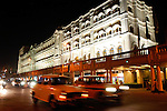 Taxis speed past the Oberoi Grand Hotel in Kolkata, India