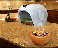 BNPS.co.uk (01202) 558833<br /> Picture: Bake.A.Dish/BNPS<br /> <br /> ****Must use full byline****<br /> <br /> This wacky kitchen gadget banishes the arduous chore of washing up after meals - because it bakes edible plates and bowls.<br /> <br /> The clever machine makes kitchenware out of bread using a top secret process means they can hold any kind of food including soups and other liquid-based meals.<br /> <br /> And it can be controlled by a mobile phone app which calculates the size of the bowl or plate according to how many calories the user needs.<br /> <br /> It can make bowls and plates of any size up to 16 inches in diameter which can be eaten at the end of a meal.<br /> <br /> The gadget, called Bake.A.Dish, is the brainchild of industrial design student Saeed Rahiminejad, who is now looking for funding to help put it into production.<br /> <br /> The Bake.A.Dish is a contender for the Electrolux Design Lab 2014 awards.