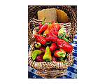 Basket of red and green peppers for sale at the Amador Farmers' Market