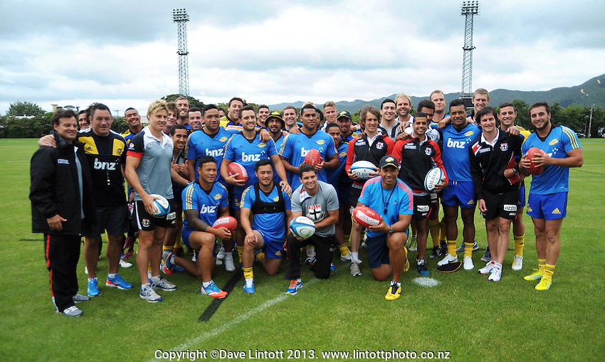 The St Kilda AFL team poses with the Hurricanes for a group photo during the  Hurricanes Super 15 rugby training at Hutt Recreation Ground, Lower Hutt, Wellington, New Zealand on Thursday, 24 January 2013. Photo: Dave Lintott / lintottphoto.co.nz