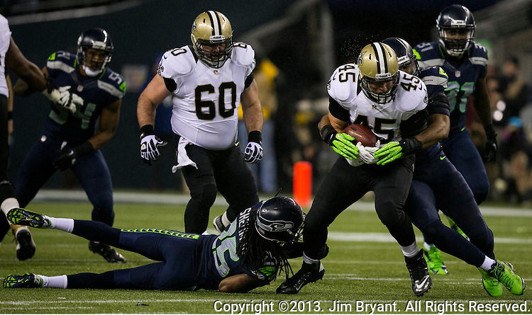 Seattle Seahawks cornerback Richard Sherman (25) and linebacker Bobby Wagner (54 tackles New Orleans Saints fullback Jed Collins during the third quarter at CenturyLink Field in Seattle, Washington on December 2, 2013. The Seahawks beat the Saints 34-7 to take the best record team in the NFL.©2013. Jim Bryant Photo. ALL RIGHTS RESERVED.