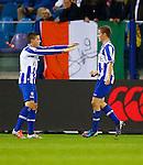 Nederland, Arnhem, 6 oktober 2012.Eredivisie.Seizoen 2012-2013.Vitesse-SC Heerenveen.Alfred Finnbogason (r.) van SC Heerenveen en Jukka Raitala (l.) van SC Heerenveen juichen nadat hij de 0-1 heeft gescoord.
