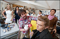 BNPS.co.uk (01202 558833)<br /> Pic: PhilYeomans/BNPS<br /> <br /> Mike applys the brylcreem to James Dean famous hair.<br /> <br /> Tinseltown comes to Dorset - Wax artist Michael Wade is surrounded with a surreal who's who of Hollywood stars in the unlikely surrounds of his Bridport studio.<br /> <br /> Michael has just completed a bumper order of silver screen idols for a new museum in America. His tiny studio is now home to John Wayne, Humphrey Bogart and Elvis as well as Sandra Bullock, Jennifer Aniston and even Marylin Monroe.<br /> <br /> Each work takes 3 months to create with a sculptor first creating the head before thousands of real hairs are individually inserted, next a hairdresser cuts and crimps, teeth made by a dentist are added along with bespoke eyes created by NHS technicians. <br /> <br /> After all this careful work Michael takes the waxwork to a dress maker to tailor a suitable outfit and then the stunning &pound;20,000 models are complete.