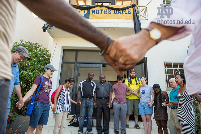 Aug. 11, 2015; Let's Share The Sun delegation join hands in prayer before departing Residence Filariose to return to the United State in Leogane, Haiti. (Photo by Barbara Johnston/University of Notre Dame)