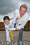 FIGHTING FIT; Killorglin judo star Jesse McCormick who won a silver medal at the National Community Games Finals in Mosney last week. He is pictured with his coach, Eugene Cotter.   Copyright Kerry's Eye 2008