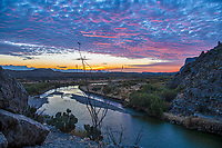 Another predawn image of the Santa Elena Canyon just before sunrise as the cloud pick up these wonderful colors. This wonderful Texas landscape with the Ocotillo and prickly pear growing along  the edge of Santa Elena Canyon as the Rio Grande river flows beneath was spectacular.  Sometimes the best time to view a sunrise is before it happens,  just as the sky starts to light up with some pre-sunrise colors can make for a spectacular image.
