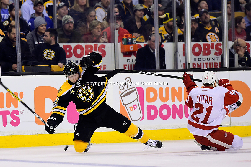 Wednesday, March 8, 2017: Detroit Red Wings left wing Tomas Tatar (21) and Boston Bruins defenseman Torey Krug (47) fall to the ice during the National Hockey League game between the Detroit Red Wings and the Boston Bruins held at TD Garden, in Boston, Mass.  Boston defeats Detroit 6-1 in regulation time. Eric Canha/CSM