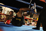 Ivan Stovall hits the canvas after being knocked down by Joey Gilbert.  Photo by Tom Smedes.