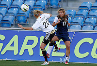 US's Tobin Heath fights for the ball with Germany's Lena Goebling during their Algarve Women's Cup soccer match at Algarve stadium in Faro, March 13, 2013.  .Paulo Cordeiro/ISI