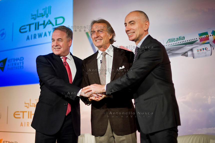 Rome, January 20 ,2015. Il Vice Presidente e Ceo del gruppo Etihad e Vice Presidente Alitalia posa con Luca Cordero di Montezemolo e Silvano Cassano al termine della conferenza stampa per la presentazione della nuova partnership tra Aliatalia e Gruppo Etihad. James Hogan,James Hogan (L) President and CEO of Etihad Aviation Group and Vice President of Alitalia, poses with Italian Luca Cordero di Montezemolo, President of Alitalia (C) and Italian Silvano Cassano CEO of Alitalia, attend the press conference to promote the new Alitalia service.