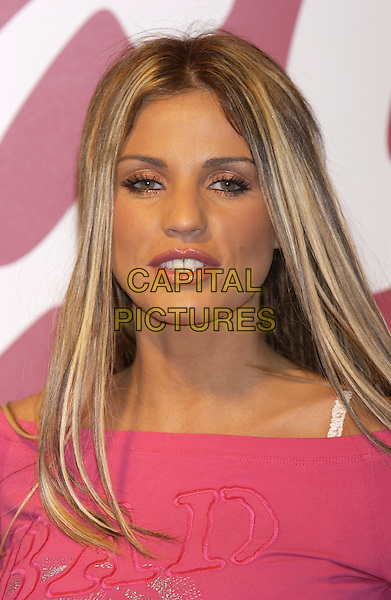 "JORDAN (KATIE PRICE) .at ""Brand Licensing 2004"" ..She is said to be looking to expand into homeware, clothing and accessories market..Earl's court exhibition centre, London 25  October 2004..portrait headshot pink top Pryce.Ref: PL.www.capitalpictures.com.sales@capitalpictures.com.©Capital Pictures."