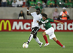 1 March 2006: Ghana's Sulley Muntari (11) tries to hold off a challenge by Mexico's Andres Guardado (19). The National Team of Mexico defeated the National Team of Ghana 1-0 at Pizza Hut Park in Frisco, Texas in an International Friendly soccer match.