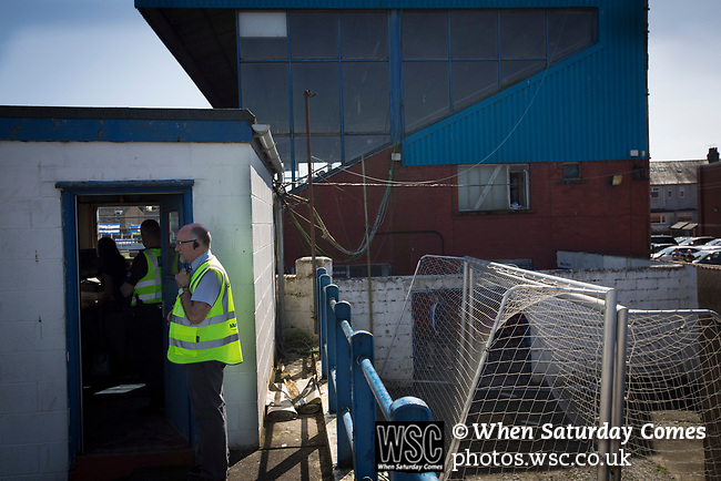 A steward keeps an eye on fans entering the ground at Palmerston Park, Dumfries before Queen of the South hosted Dundee United in a Scottish Championship fixture. The home has played at the same ground since its formation in 1919. Queens won the match 3-0 watched by a crowd of 1,531 spectators.