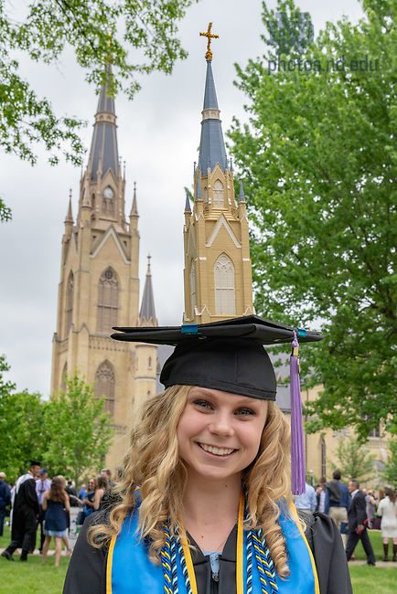 May 20, 2018; Architecture grad with a model of the Basilica on her cap, Commencement 2018 (Photo by Matt Cashore/University of Notre Dame)