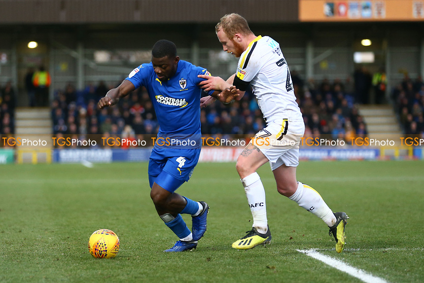Deji Oshilaja of AFC Wimbledon and Liam Boyce of Burton Albion during AFC Wimbledon vs Burton Albion, Sky Bet EFL League 1 Football at the Cherry Red Records Stadium on 9th February 2019