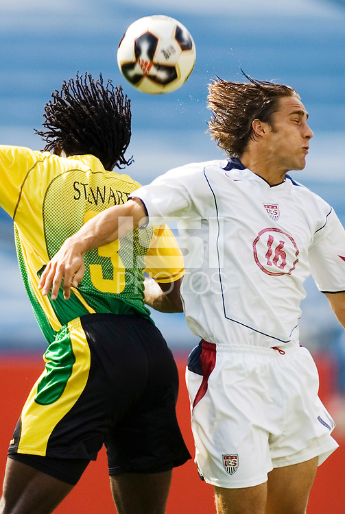 Jamaica's Damion Stewart and USA's Josh Wolff go up for a header. The United States defeated Jamaica 3 to 1 in quarterfinal CONCACAF Gold Cup action at Gillette Stadium, Foxbourgh, MA, on July 16, 2005.