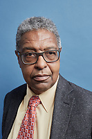 "Portraits of Dr. William A. Darity, Jr., Samuel DuBois Cook Professor of Public Policy, Professor in the Sanford School of Public Policy, Professor of African and African American Studies, Professor of Economics at the Samuel DuBois Cook Center for Social Equity at Duke University  in Durham, North Carolina, Monday, June 10, 2019  (Justin Cook for The Wall Street Journal)<br /> <br /> STRATECON<br /> <br /> For decades, William A. Darity Jr. and Darrick Hamilton toiled in obscurity, two African-American economists touting guaranteed jobs and reparations for slave descendants, blasting mainstream economists for failing to address racial disparities. - - - - - - Now the two scholars find themselves in the limelight of the 2020 presidential campaign. - - - - - - On stage at a March conference for liberal activists, Mr. Hamilton gets a hug from New Jersey Sen. Cory Booker, who tells him: ""You've really laid the foundation for a lot of things that we're doing."" Backstage, California Sen. Kamala Harris chats with Mr. Hamilton, an Ohio State University professor who helped her shape a middle-class tax cut proposal. Former Texas Rep. Beto O'Rourke, asked in a television interview how to frame the party's new platform, replies: ""There's an extraordinary economist named Darrick Hamilton who talks about a more conscious capitalism."" - - - - - - For Mr. Hamilton, and for his Duke University mentor, Mr. Darity, the frequent engagement with Democratic hopefuls marks a breakthrough. ""I'm becoming mainstream,"" says Mr. Hamilton, who has also advised Vermont Sen. Bernie Sanders on job guarantees and Massachusetts Sen. Elizabeth Warren on student debt relief. - - - - - - Many Democratic lawmakers and voters are moving left, creating an opening for big-government solutions to perceived free-market failures. They talk more explicitly about race, appealing to the party's minority-heavy base. Sweeping ideas – the grander the better -- are more fashionable than the ""incrementalism�"